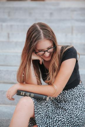 girl with glasses and a bible